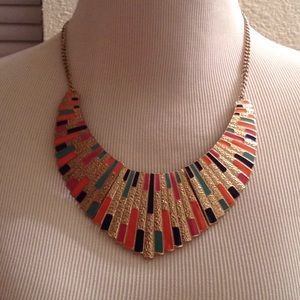 Golden necklace with pink, blue and orange